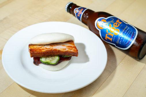pork bun with bottle of tiger beer