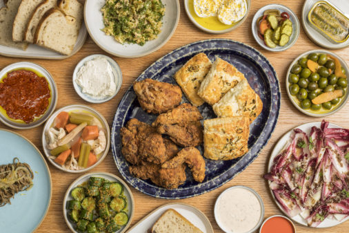 Fried chicken brunch spread of dishes