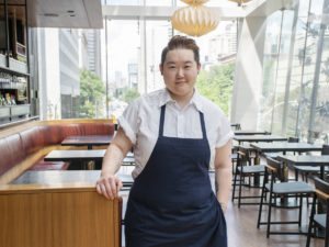 chef eva chin standing in kojin