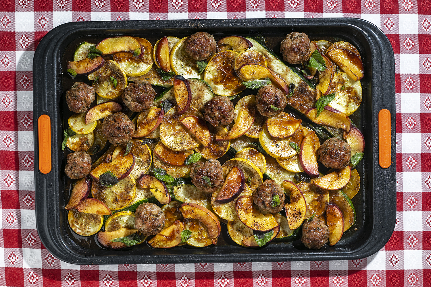 Sheet Pan Tingly Meatballs with Charred Peaches and Summer Squash